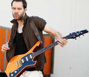 Shredding Guitars is Paul Gilbert's Job